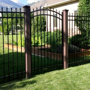 Trex Fence posts with ornamental arch top gate