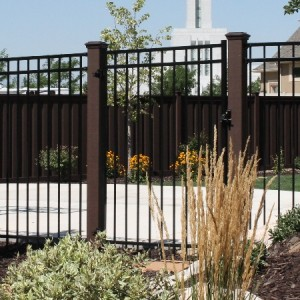 Trex Fence posts with ornamental iron gate