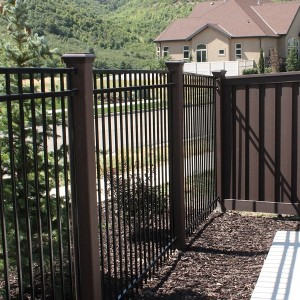 Trex Fence posts with ornamental iron panels