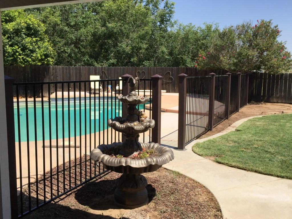 Trex Fence Posts with Ornamental Panels Around Pool