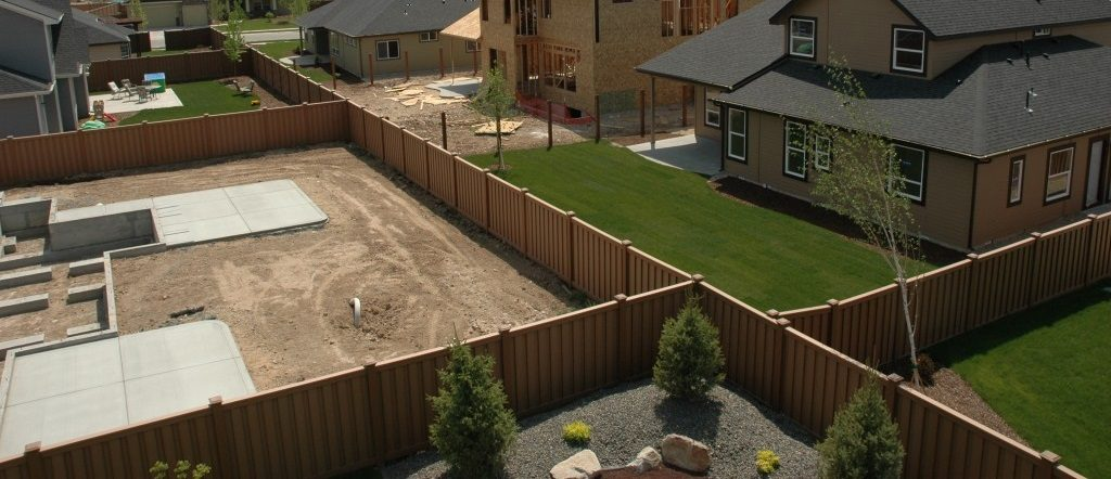 Fenced backyards in new housing development