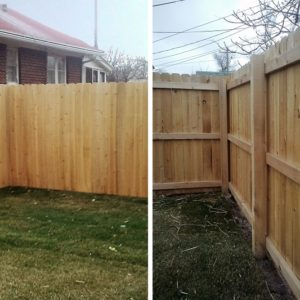 Stockade style wood fence with 2x4 back rails