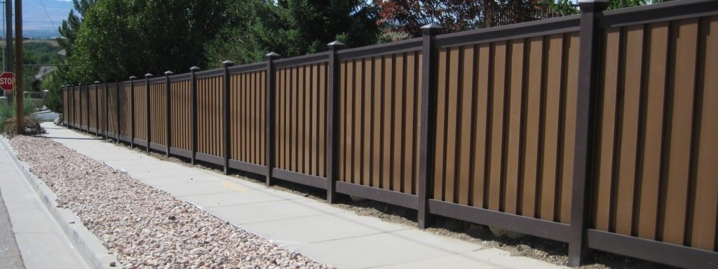 Trex Fencing with dark brown posts and rails and tan pickets