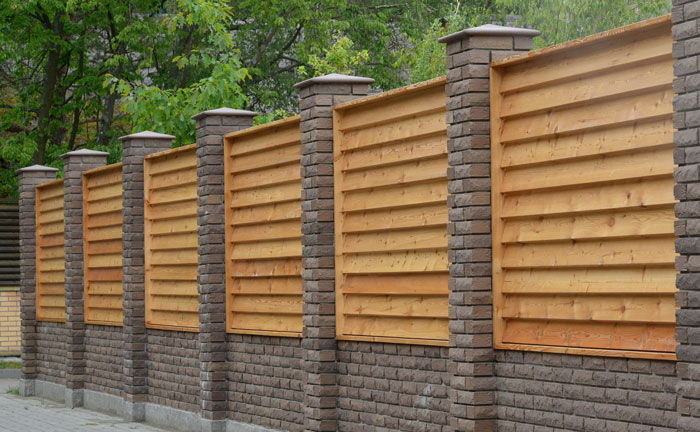 Louvered Wood Fence Panels inserted between brick columns