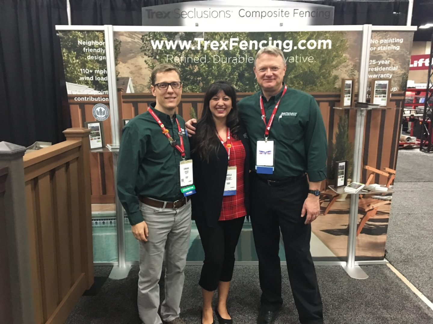 Staff members in the Trex Fencing booth at Fencetech 2017 in San Antonio