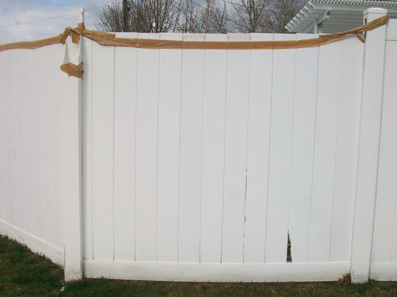 Vinyl-Fence-Broken-and-Fixed-with-Tape